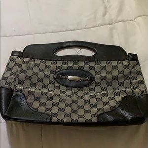 A Gucci purse and a Surface.